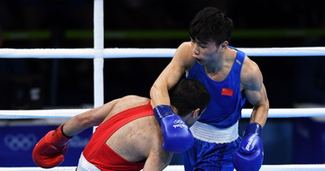男子52公斤级:中国选手胡建关获铜牌