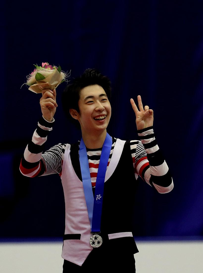 中国选手金博洋领奖后庆祝。